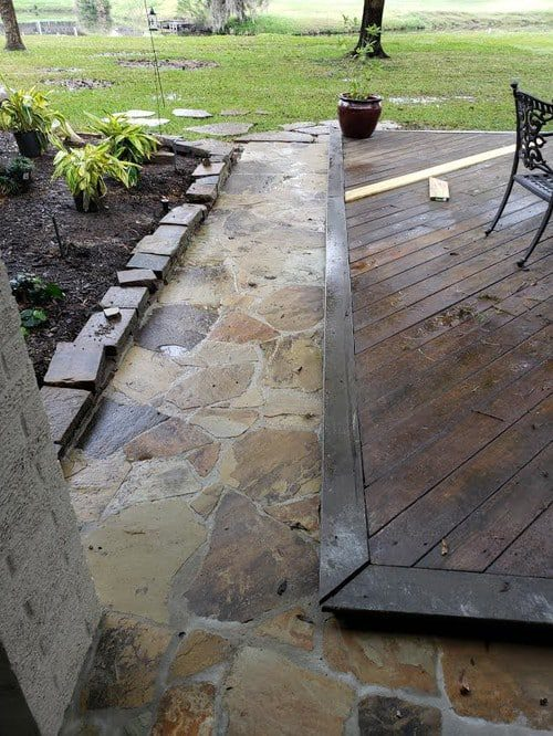flagstone patio installation by Helms Landscape
