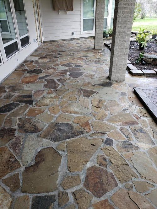 the best flagstone patio installation by Helms Landscape