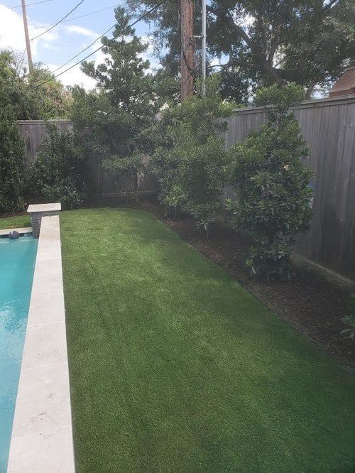 synthetic lawn installation by Helms Landscape