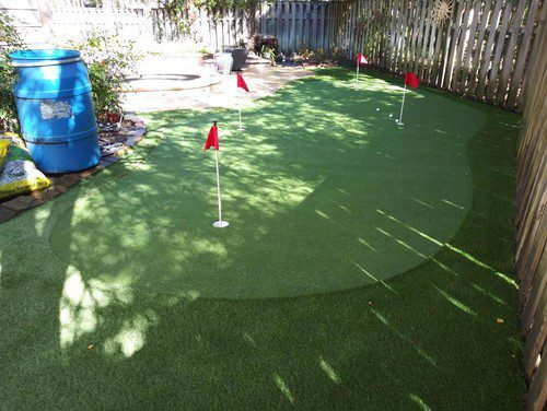 smooth putting greens installation by Helms Landscape