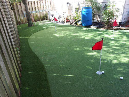 cool putting greens installation by Helms Landscape