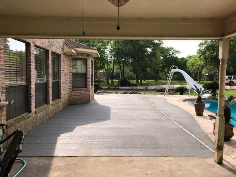 Concrete patio extensions professionally installed by Helms Landscaping in Houston Texas